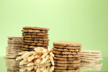 galettes: tasty crispbread and ears, on green background