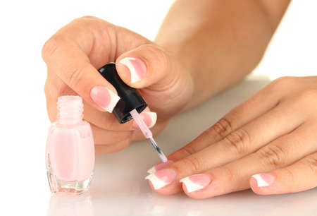 Woman makes herself a French manicure, on white background Stock Photo - 16570379