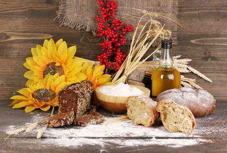 Rye bread on wooden table on wooden background photo