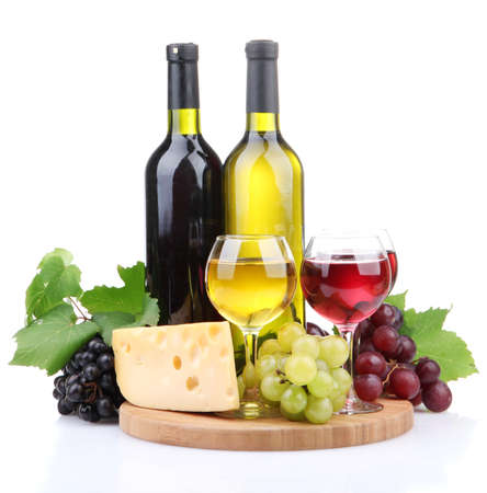 bottles and glasses of wine, assortment of grapes and cheese isolated on white photo