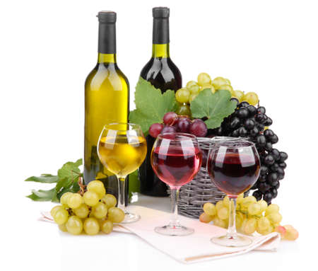 bottles and glasses of wine and grapes in basket, isolated on white photo