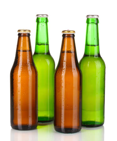 Coloured glass beer bottles isolated on white photo