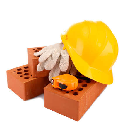 helmet, roulette, bricks and gloves isolated on white photo