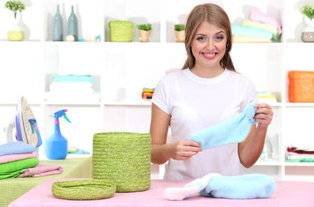 domesticity: Young girl puts socks in room