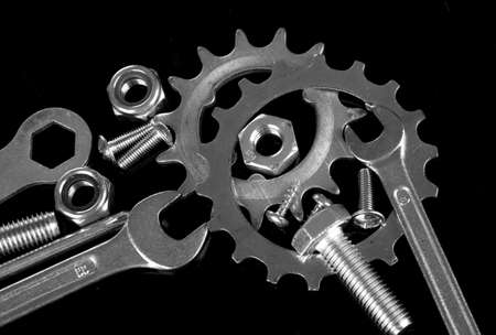 Machine gear, metal cogwheels, nuts and bolts isolated on black Stock Photo - 16603513