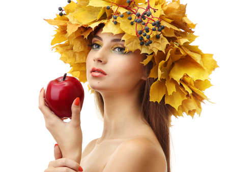 beautiful young woman with yellow autumn wreath and apple, isolated on white Stock Photo - 17051706