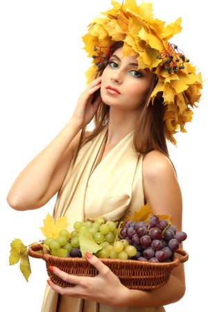 beautiful young woman with yellow autumn wreath and grapes in basket, isolated on white Stock Photo - 17051708