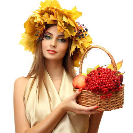 beautiful woman with wreath and basket with apples and berries, isolated on white Stock Photo - 17051747