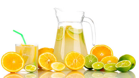 Citrus lemonade in pitcher and glass of citrus around isolated on white Stock Photo - 16618710