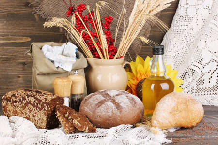Different types of rye bread on wooden table on autumn composition background Stock Photo - 16619964