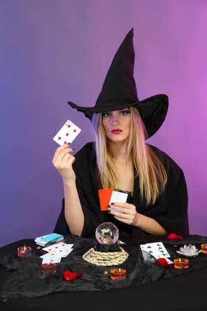 Witch - fortuneteller on color background Stock Photo - 17289419