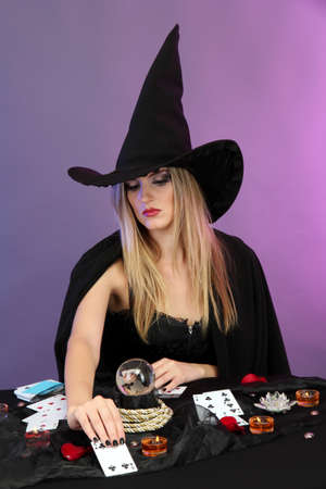 Witch - fortuneteller on color background Stock Photo - 17289418