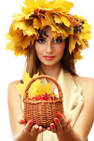 beautiful woman with wreath and basket with barberry, isolated on white photo