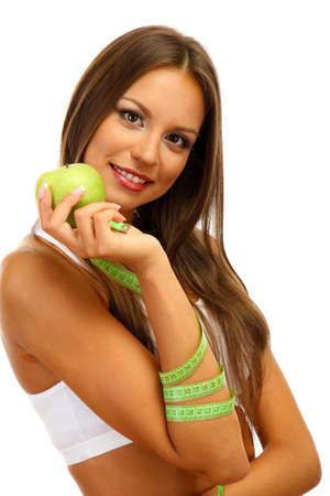 beautiful young woman with green apple and measure tape, isolated on white Stock Photo - 17051846