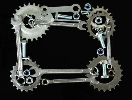 Machine gear, metal cogwheels, nuts and bolts isolated on black Stock Photo - 16647161