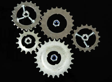 Metal cogwheels, nuts and bolts isolated on black Stock Photo - 16646894