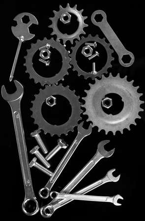 Machine gear, metal cogwheels, nuts and bolts isolated on black Stock Photo - 16646889