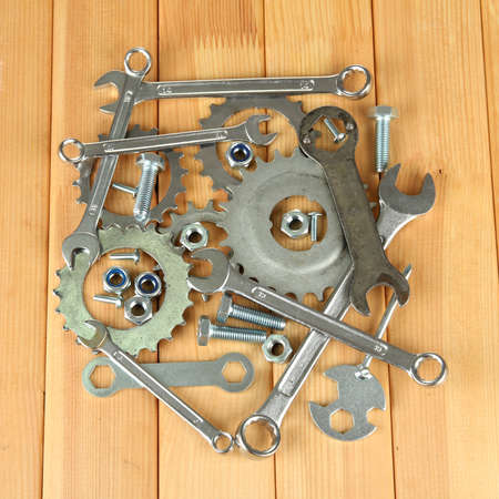 Machine gear, metal cogwheels, nuts and bolts on wooden background Stock Photo - 16647158