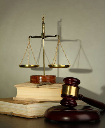 Golden scales of justice, gavel and books on grey background Stock Photo - 16646882