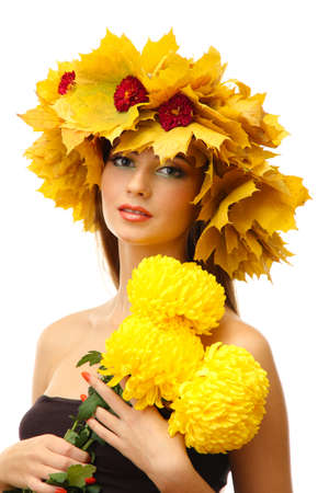 beautiful young woman with autumn wreath and chrysanthemums, isolated on white photo