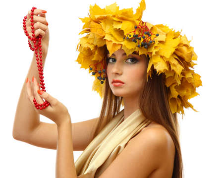beautiful young woman with yellow autumn wreath and beads, isolated on white Stock Photo - 17051829