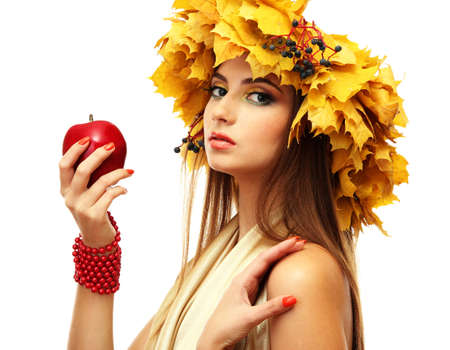 beautiful young woman with yellow autumn wreath and apple, isolated on white Stock Photo - 17051824