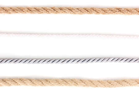 Collection of various ropes isolated on white photo