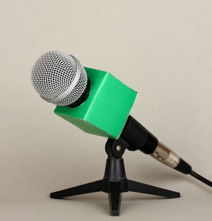 Microphone on stand on grey background photo