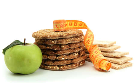 tasty crispbread, apple and measuring tape, isolated on white photo
