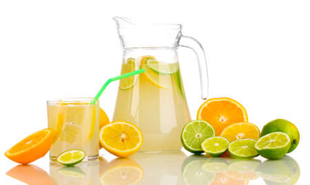 Citrus lemonade in pitcher and glass of citrus around isolated on white photo