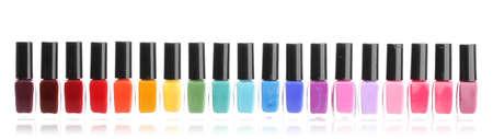 nail polish bottle: Group of bright nail polishes isolated on white