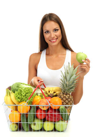 beautiful young woman with fruits and vegetables in shopping basket, isolated on white Stock Photo - 17051861