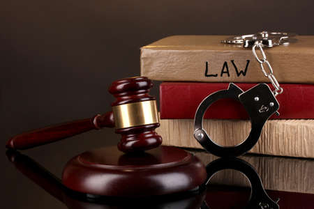 Gavel, handcuffs and books on law isolated on black close-up Stock Photo - 16725688
