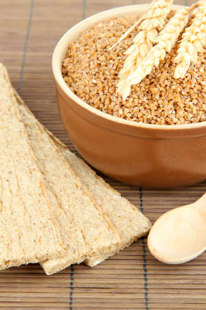 Brown bowl full of wheat bran photo