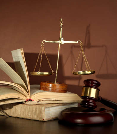 Golden scales of justice, gavel and books on brown background Stock Photo - 16747855