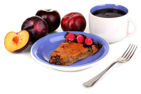 Tasty pie on blue plate with plums isolated on white Stock Photo - 16752487