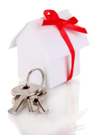 key box: Small house with key isolated on white Stock Photo
