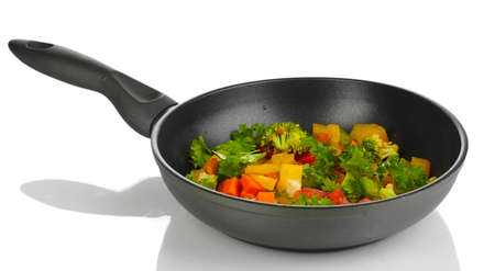 Sliced fresh vegetables in pan isolated on white Stock Photo - 16751866