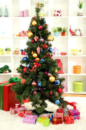 Decorated Christmas tree on home interior background Stock Photo - 16791518