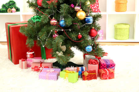 Decorated Christmas tree on home inter background Stock Photo - 16823571