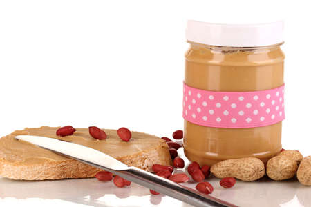 Delicious peanut butter in jar with sandwich isolated on white photo