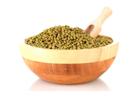 Green mung beans  with scoop in bowl isolated on white photo