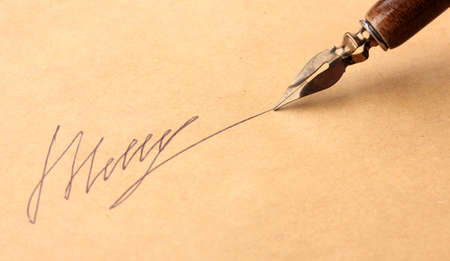 Closeup of signature (fake, not real) and ink pen, on old paper Stock Photo - 16739575