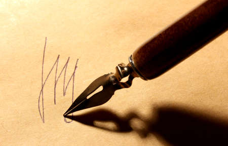 Closeup of signature (fake, not real) and ink pen, on old paper Stock Photo - 16739545
