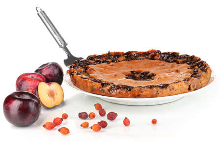 Tasty pie on plate with plums isolated on white Stock Photo - 16739512