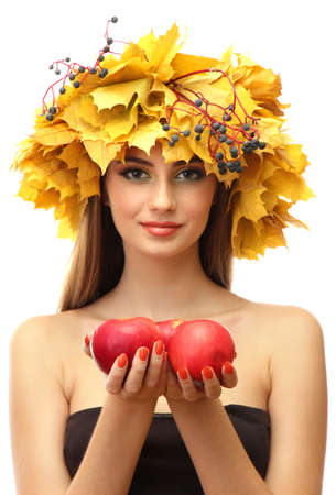 beautiful young woman with yellow autumn wreath and apples, isolated on white photo