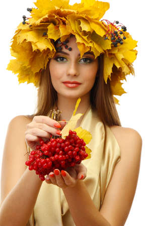 beautiful young woman with yellow autumn wreath and viburnum, isolated on white photo