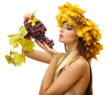 beautiful young woman with yellow autumn wreath and grapes, isolated on white Stock Photo - 17051807