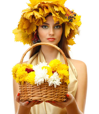 beautiful young woman with yellow autumn wreath and basket with flowers, isolated on white Stock Photo - 17051800