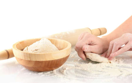 Preparing pizza dough isolated on white photo